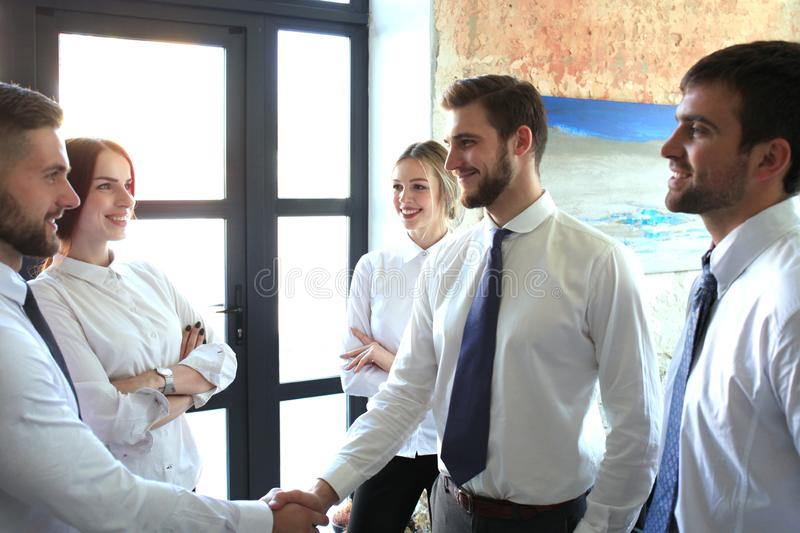 Business people shaking hands, finishing up a meeting royalty free stock images