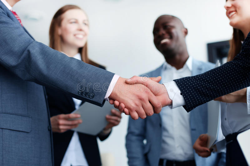 Business people shaking hands. Finishing up a meeting stock photography