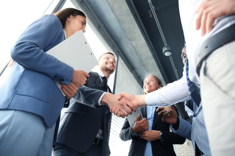 Business people. Shaking hands, finishing up a meeting royalty free stock photos