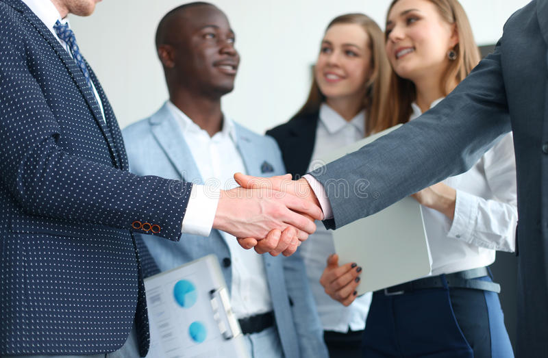 Business people shaking hands. Finishing up a meeting royalty free stock photo