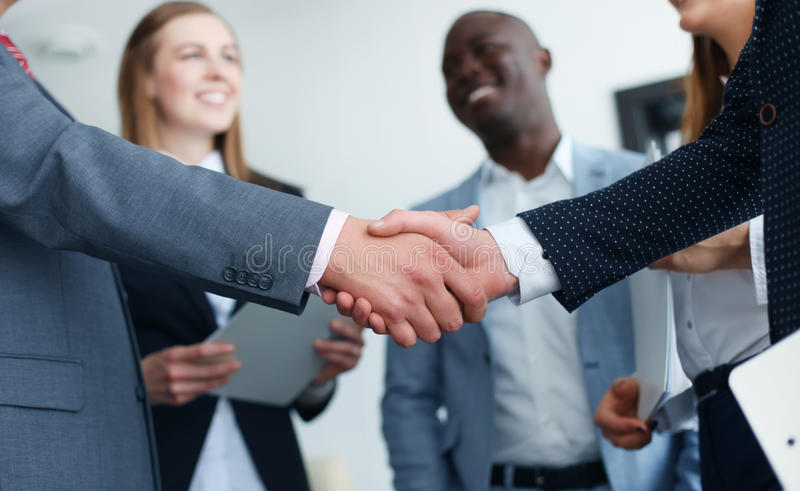 Business people shaking hands stock photography