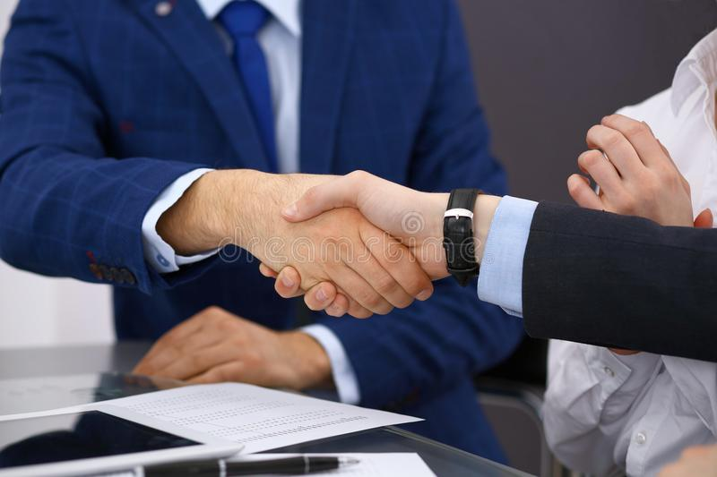 Business people shaking hands, finishing up a meeting. Audit, tax service or agreement concept.  stock photography