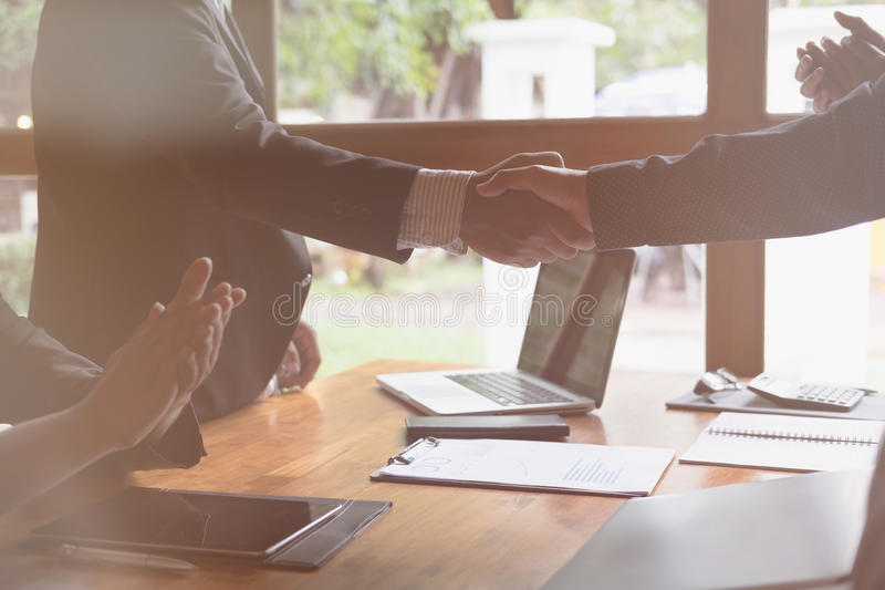 Business people shaking hands after finishing up a meeting. Businessman handshaking after conference. teamwork, partnership, coll. Business people shaking hands stock image