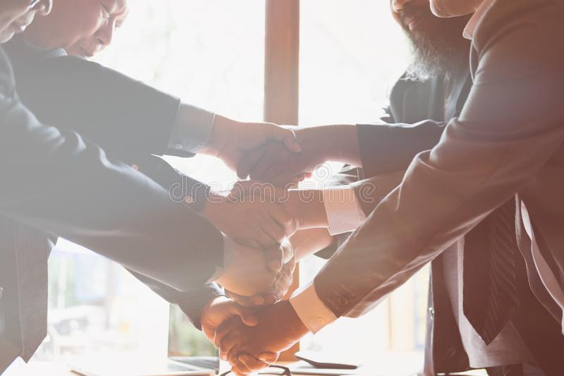Business people shaking hands after finishing up a meeting. Businessman handshaking after conference. teamwork, partnership, coll. Business people shaking hands royalty free stock photos