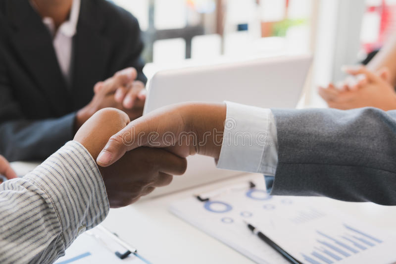 Business people shaking hands after finishing up a meeting. Businessman handshaking after conference. teamwork, partnership, coll. Business people shaking hands royalty free stock images