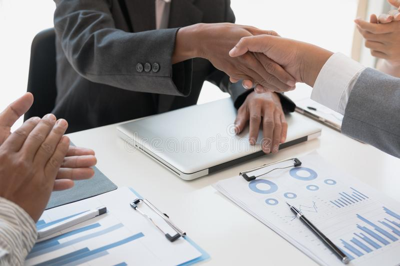 Business people shaking hands after finishing up a meeting. Businessman handshaking after conference. teamwork, partnership, coll. Business people shaking hands royalty free stock photography