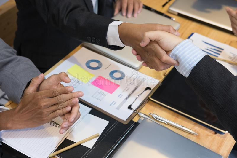 Business people shaking hands after finishing up a meeting. Businessman handshaking after conference. teamwork, partnership, coll. Business people shaking hands stock photos