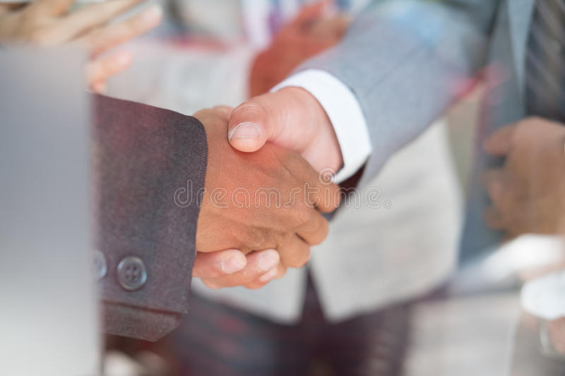 Business people shaking hands after finishing up a meeting. Businessman handshaking after conference. teamwork, partnership, coll. Business people shaking hands stock photography