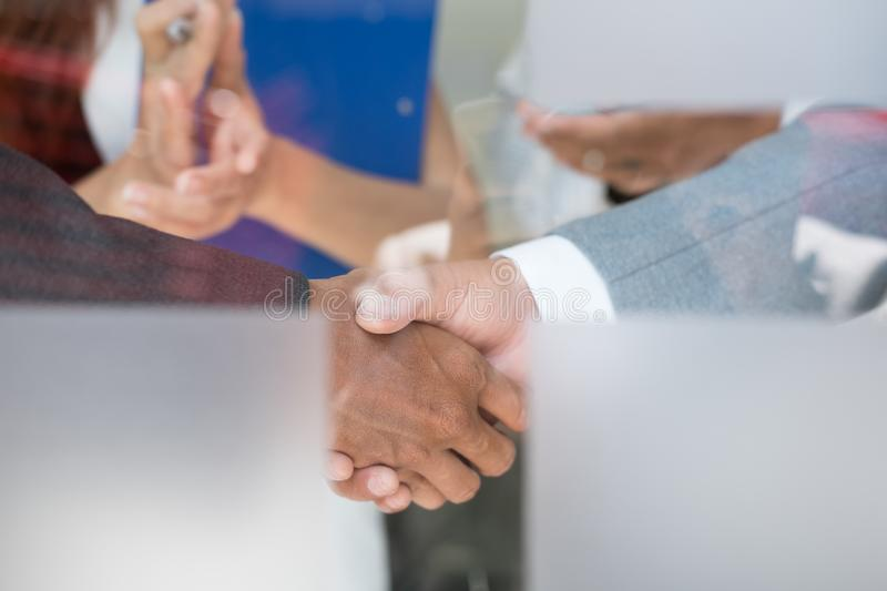 Business people shaking hands after finishing up a meeting. Businessman handshaking after conference. teamwork, partnership, coll. Business people shaking hands royalty free stock image