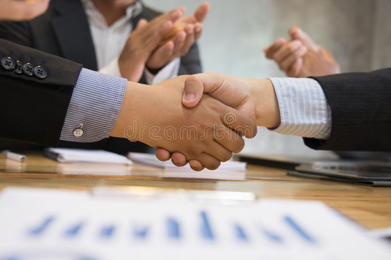 Business people shaking hands after finishing up a meeting. Businessman handshaking after conference. teamwork, partnership, coll. Business people shaking hands stock images