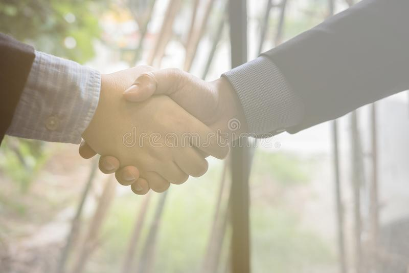 Business people shaking hands after finishing up a meeting. Businessman handshaking after conference. teamwork, partnership, coll. Business people shaking hands stock photo