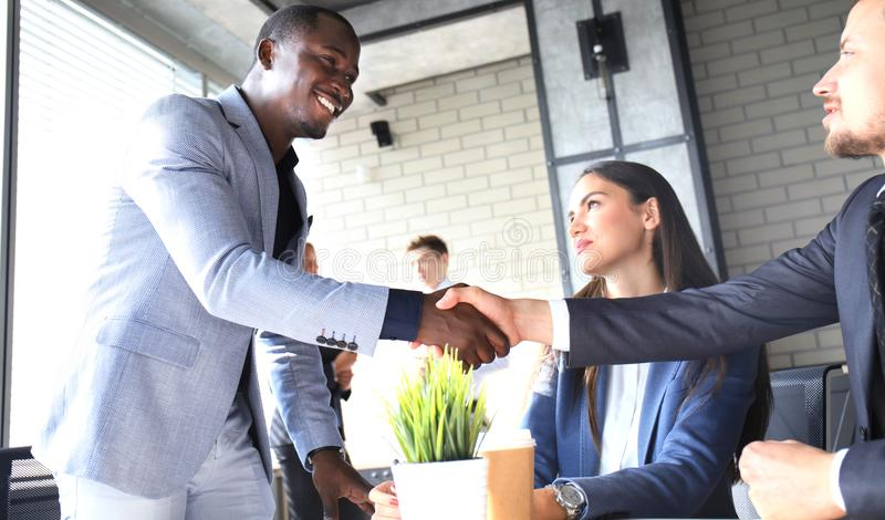 Business people shaking hands, finishing up a meeting. royalty free stock photos