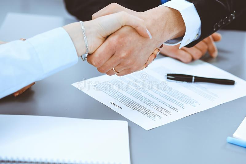 Business people shaking hands, finishing up a meeting stock photos