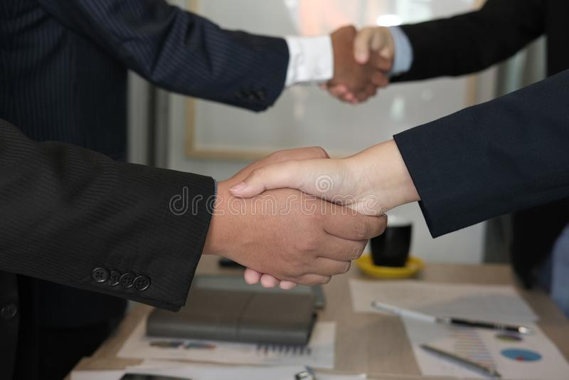 Business people shaking hands after finishing up meeting. colleagues handshaking after conference. Greeting deal, teamwork, partnership, collaboration stock photography