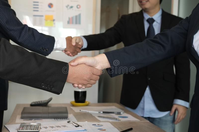 Business people shaking hands after finishing up meeting. colleagues handshaking after conference. Greeting deal, teamwork, partnership, collaboration royalty free stock image