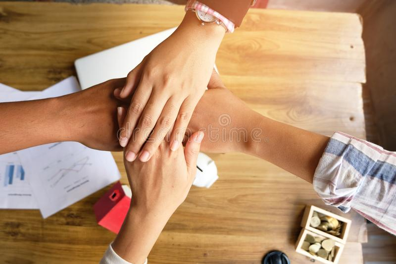 Business people shaking hands, finishing up a meeting, concept of team work royalty free stock photo