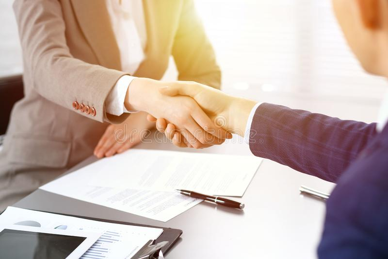 Business people shaking hands, finishing up a meeting. Papers signing, agreement and lawyer consulting concept stock images