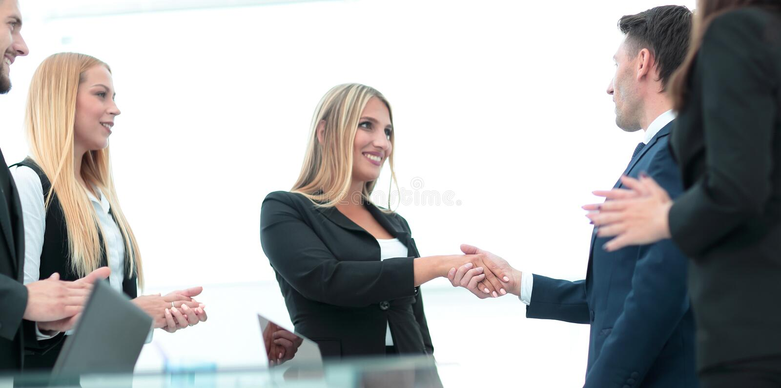 Business partner greeting each other with handshake stock photos