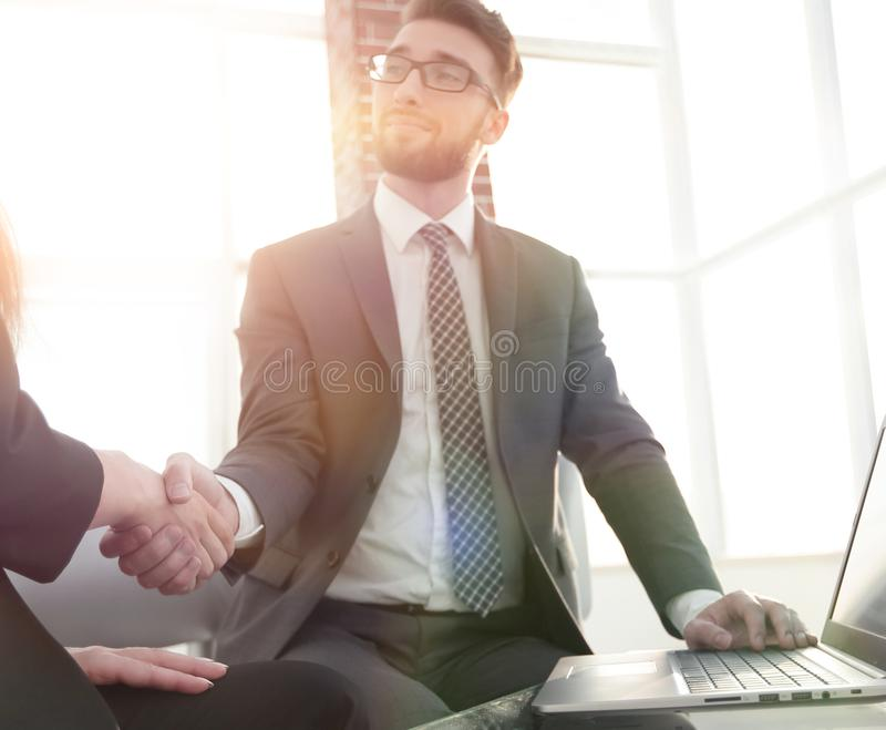 Successful businessmen handshaking after good deal. Business people shaking hands, finishing up a meeting stock images