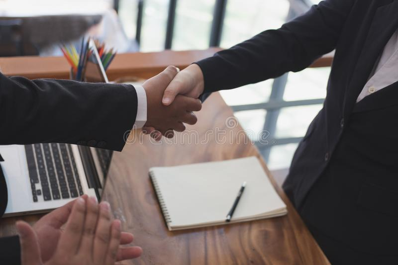 Business people shaking hands after finishing up a meeting. Two. Colleagues handshaking after conference. Greeting deal, teamwork, partnership, collaboration stock image