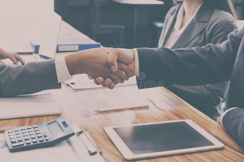 Business people shaking hands after finishing up a meeting. Two royalty free stock photos