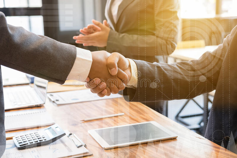 Business people shaking hands after finishing up a meeting. Two. Colleagues handshaking after conference. Greeting deal, teamwork, partnership, collaboration stock photography