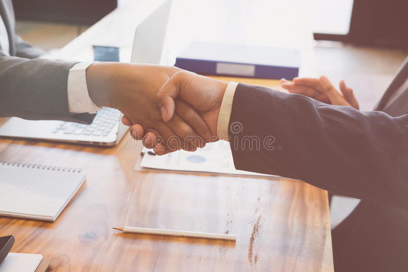 Business people shaking hands after finishing up a meeting. Two. Colleagues handshaking after conference. Greeting deal, teamwork, partnership, collaboration stock photos