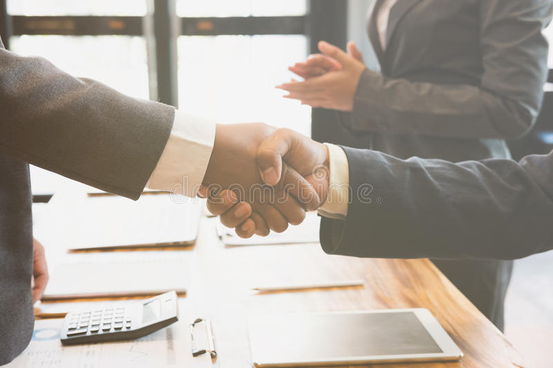 Business people shaking hands after finishing up a meeting. Two. Colleagues handshaking after conference. Greeting deal, teamwork, partnership, collaboration royalty free stock photography