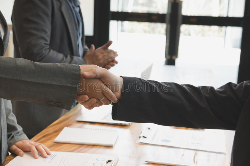 Business people shaking hands after finishing up a meeting. Two. Colleagues handshaking after conference. Greeting deal, teamwork, partnership, collaboration stock images
