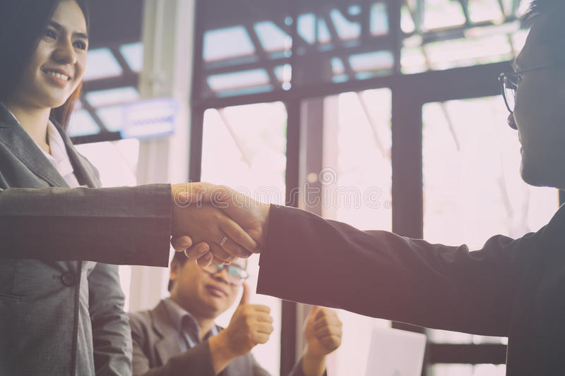 Business people shaking hands after finishing up a meeting. Two. Colleagues handshaking after conference. Greeting deal, teamwork, partnership, collaboration royalty free stock images