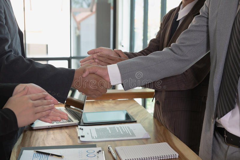 Business people shaking hands after finishing up a meeting. Two. Colleagues handshaking after conference. Greeting deal, teamwork, partnership, collaboration royalty free stock image