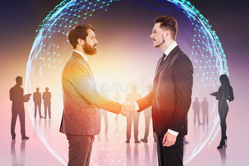 Business people shaking hands in global world stock image