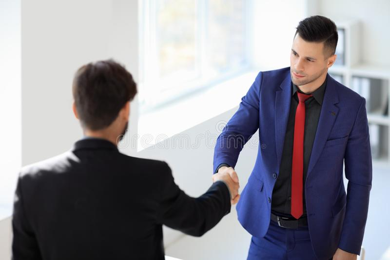 Business people shaking hands after good deal. Business partnership meeting concept stock images