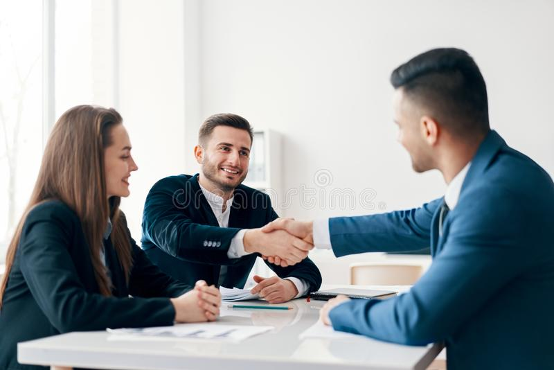 Business people shaking hands after good deal. Business partnership meeting concept stock photo