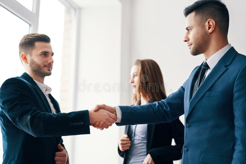 Business people shaking hands after good deal. Business partnership meeting concept royalty free stock photography
