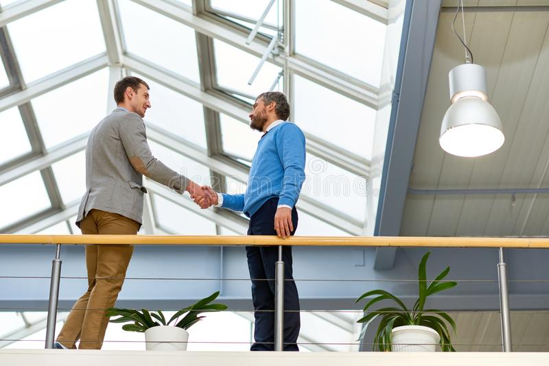 Business People Shaking Hands Indoors stock photography