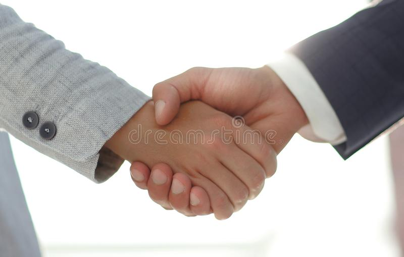Business people shaking hands isolated on white background. Business people handshake in modern office. Greeting deal concept stock photo