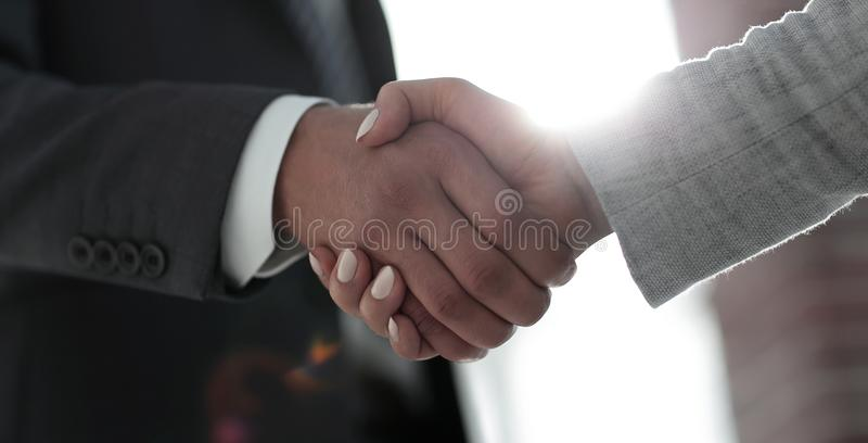 Business people shaking hands isolated on white background. Business people handshake in modern office. Greeting deal concept stock photography