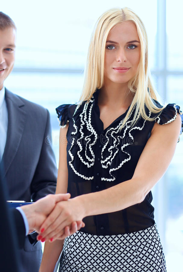 Business people shaking hands after meeting.  stock photo