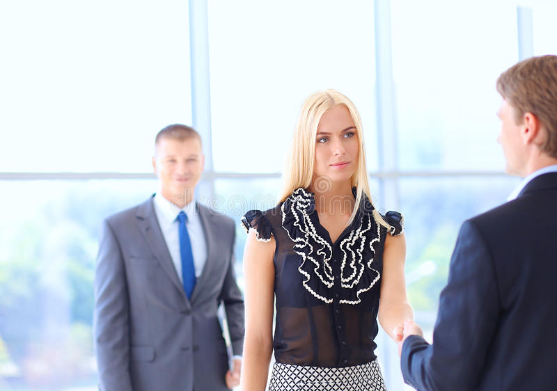 Business people shaking hands after meeting.  stock photos