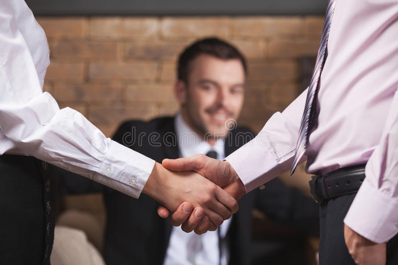 Business people shaking hands after meeting in cafe. stock image