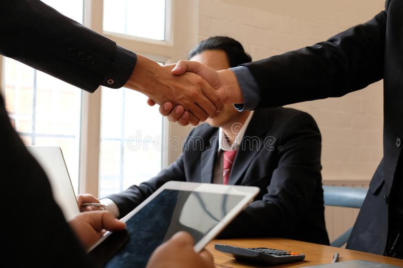 Business people shaking hands after meeting. colleagues handshaking after conference. Greeting deal, teamwork, partnership royalty free stock photos
