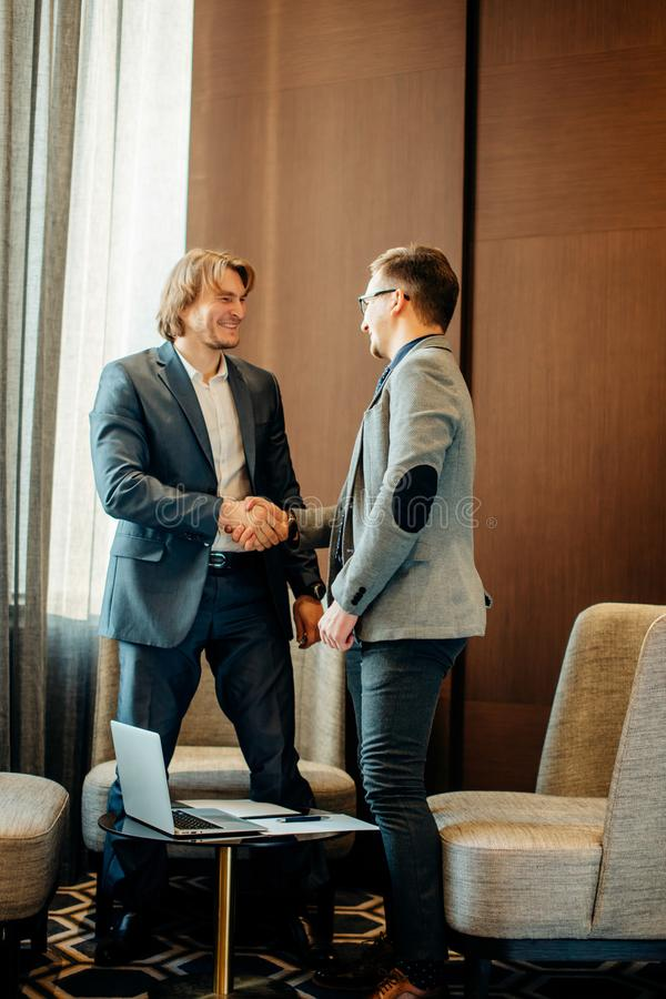 Business people shaking hands on meeting, great deal royalty free stock photography