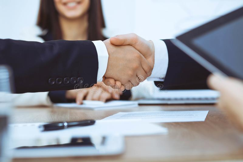 Business people shaking hands at meeting or negotiation in the office. Handshake concept. Partners are satisfied because royalty free stock photos