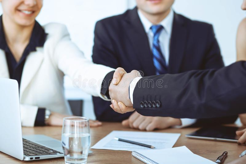 Business people shaking hands at meeting or negotiation in the office. Handshake concept. Partners are satisfied because. Signing contract stock photo