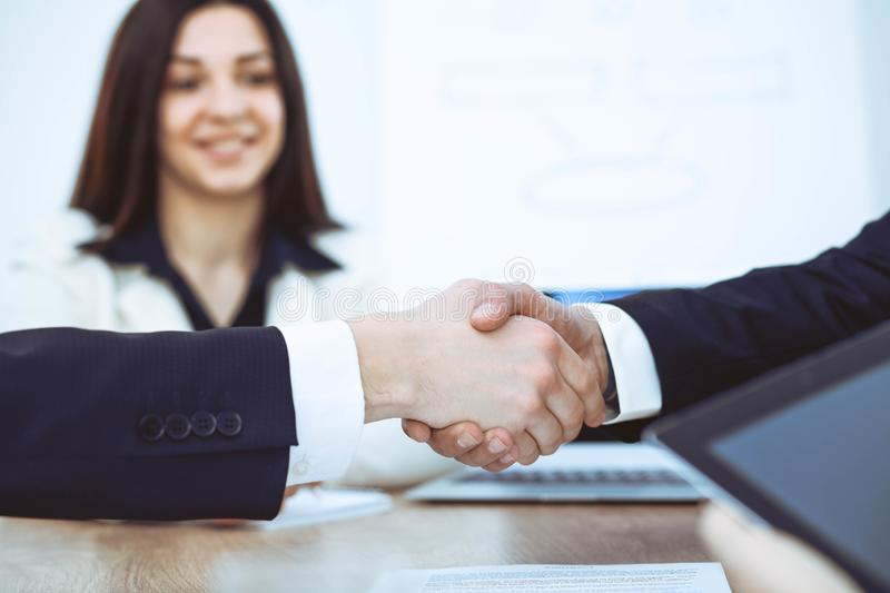 Business people shaking hands at meeting or negotiation in the office. Handshake concept. Partners are satisfied because. Signing contract royalty free stock photos