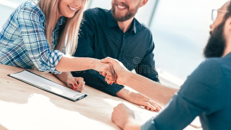 Business people shaking hands at a meeting in the office. stock images