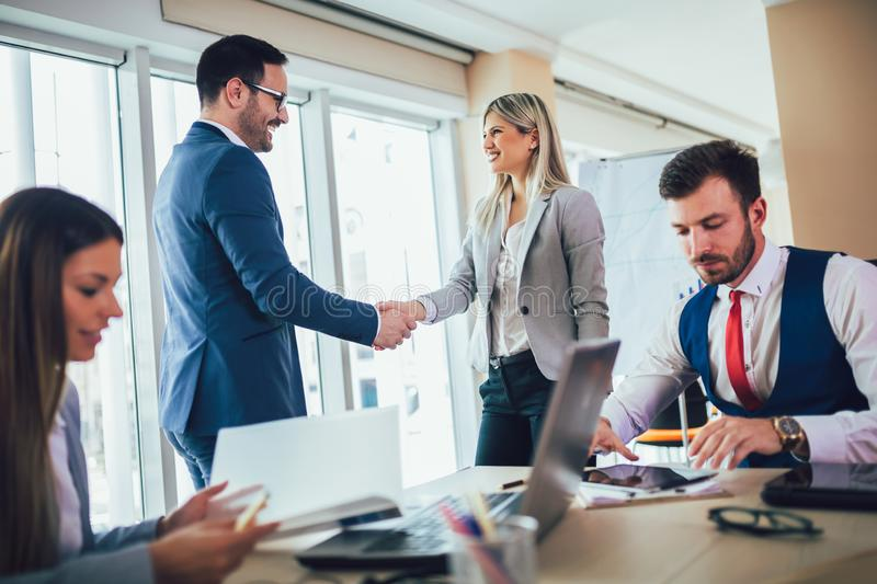 Business people shaking hands in meeting room. Selective focus stock photo