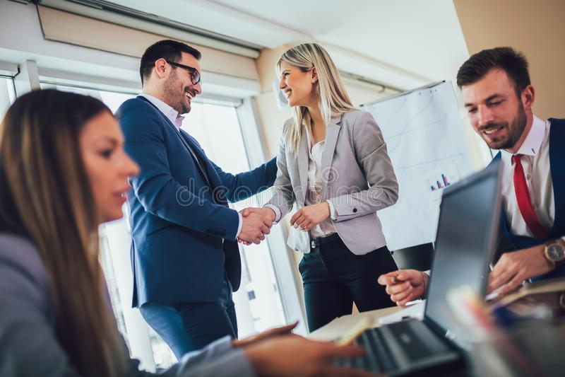 Business people shaking hands in meeting room. Selective focus royalty free stock photography