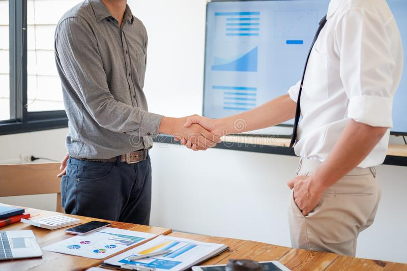 Business people shaking hands in meeting room, Successful deal after meeting royalty free stock image